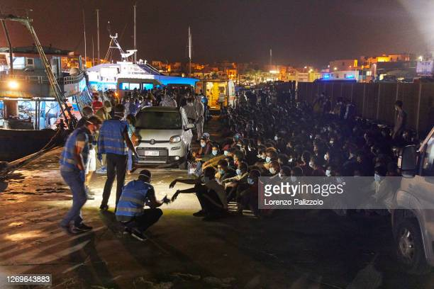 Group of 450 migrants coming from sub-Saharan Africa who left Libya on a big fishing ship, awaits health checks before being transferred to the...