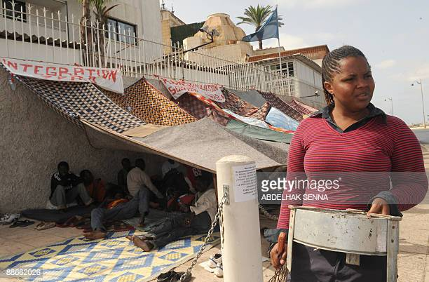 A group of 50 Subsaharan refugees stage a sitin under a makeshift shelter in front of the UN High Commissioner for refugees office in Rabat on June...
