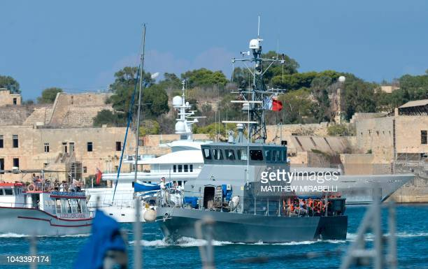 A group of 58 migrants picked up from small boats by the migrant ship Aquarius and transferred to an Armed Forces of Malta patrol boat arrives at Hay...