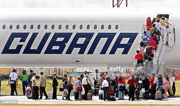 A group of 69 Cuban doctors embark on a Cubana de Aviacion aircraft to return to Cuba at Brasilia's International Airport 15 April 2005 The Brazilian...