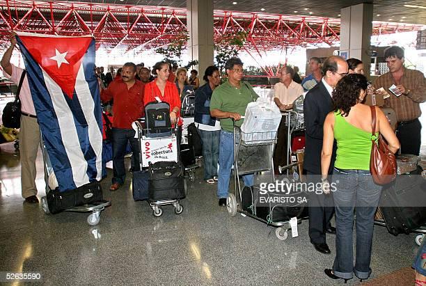 A group of 69 Cuban doctors proceed to checkup to embark on a Cubana de Aviacion aircraft to return to Cuba at Brasilia's International Airport 15...