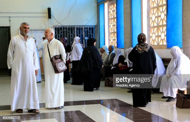 A group of 90 Syrian pilgrims who pass through Cilvegozu border gate to Turkey with buses wait to take off the Holy city of Mecca at the Bab alHawa...