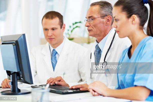 Group of a doctors checking Results
