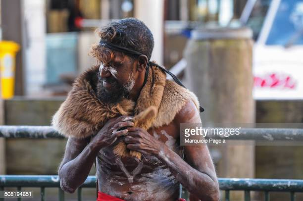 CONTENT] A group of Aboriginal Australians playing some Aboriginal music instruments on the Circular Quay ferry terminal The man in the picture is...