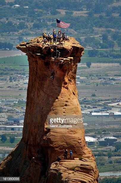 MONUMENTA group of about 30 people erect a US flag on top of Independence Monument at the Colorado National Monument near Fruita on Tuesday Members...