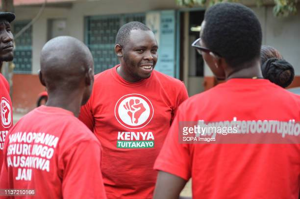 A group of activists allied to Kenyas Red Vests Movement are seen discussing after a church service Activists allied to Kenyas Red Vests Movement...