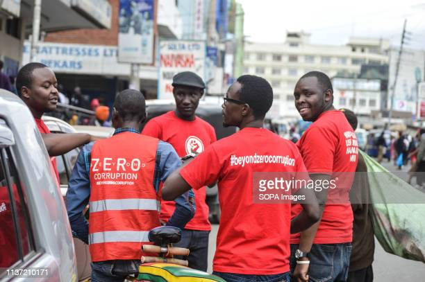 A group of activists allied to Kenyas Red Vests Movement are seen engaging a member of the public in the streets of Nakuru during the anticorruption...