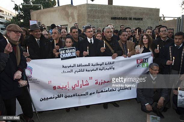 A group of activists and journalists stage a protest against gun attack on French Magazine Charlie Hebdo in front of French Embassy in Morocco on...