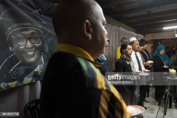 A group of activists friends and supporters take part in a candlelight vigil for the late South African antiapartheid campaigner Winnie...