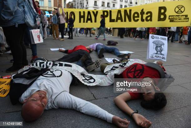 A group of activists from extinction rebellion seen lying on the ground pretending to be dead during a performance Extinction Rebellion activists...