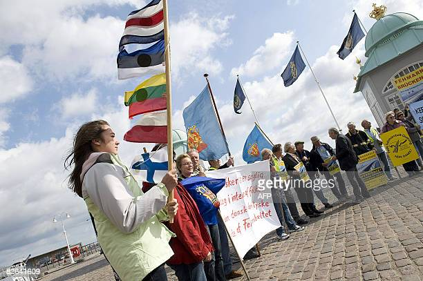 A group of activists gather to protest the signing of the Fehmarnbelt Bridge contract in Copenhagen on September 3 2008 The contract was signed by...