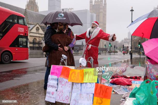 A group of activists in Parliament Square attempt to break the world record for the longest hug to try to highlight the plight of the homeless at...