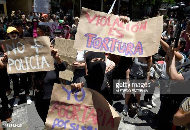 TOPSHOT A group of activists take part in a protest called by civil organizations against the police after four police officers had been accused of...