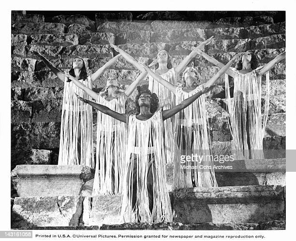 Group of actress praising Jesus wearing white fridged costume in a scene from the film 'Jesus Christ Superstar', 1973.