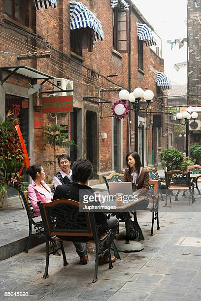 Group of adults at outdoor table