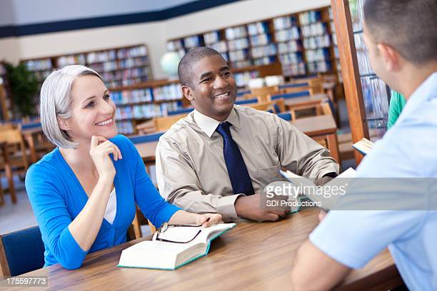 group of adults enjoying book study together - book club meeting stock pictures, royalty-free photos & images
