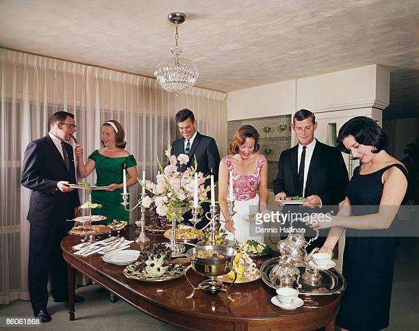 Group of adults enjoying dinner party