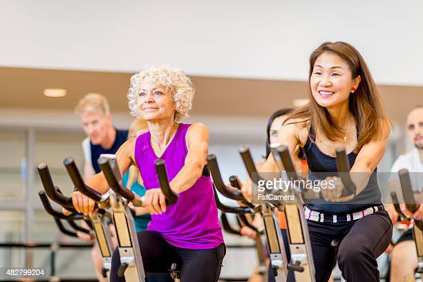 Group of Adults on Exercise Bikes