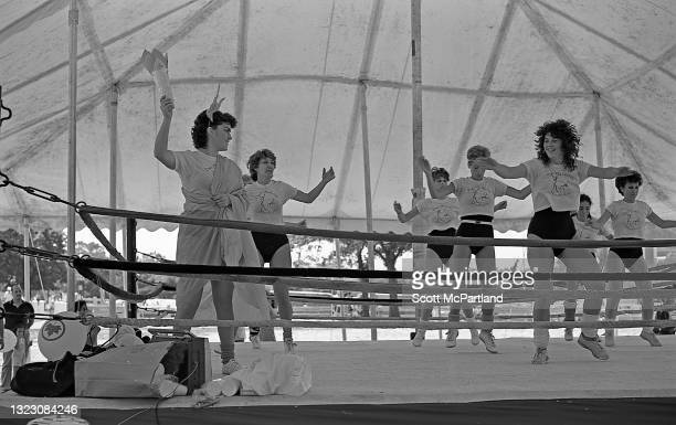 Group of aerobics instructors work their routine in a boxing ring in Flushing Meadows Park, in the Corona neighborhood, Queens, New York, New York,...