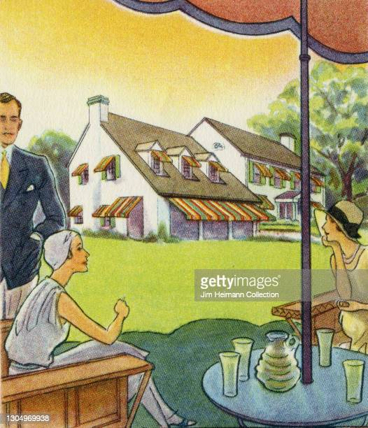Group of affluent people gather on the lawn under an awning smoking cigarettes and drinking refreshments. The man wears a smart jacket and tie while...