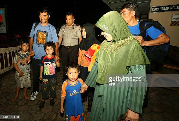 A group of Afghan asylum seekers arrive at a police station in Malang town East Java province early April 21 2012 Indonesian authorities were...