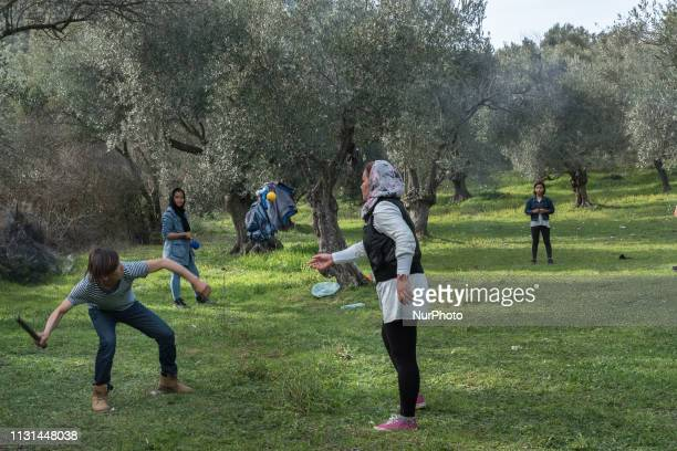 A group of Afghan asylumseeker play cricket in the olive grove behind Moria Camp on Lesvos March 9 2019