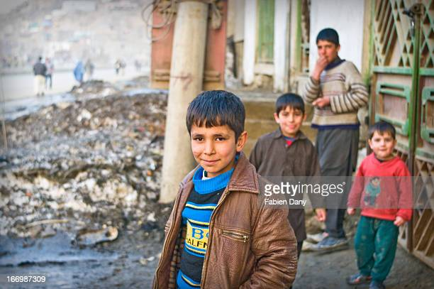CONTENT] Group of afghan boys curious at the camera met in the streets of Kabul