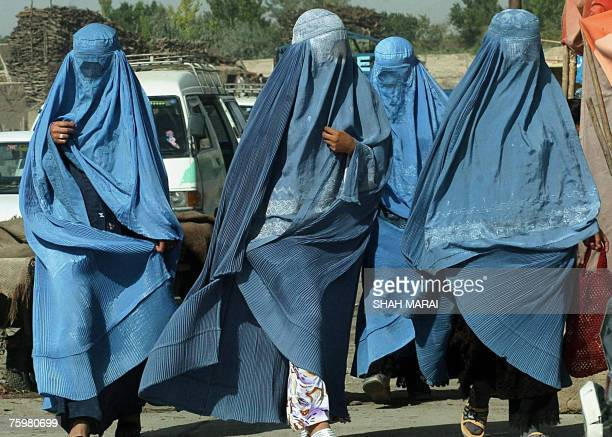A group of Afghan women clad in burqas walk towards a market in Ghazni 04 August 2007 Afghanistan's Taliban are holding out for a neutral venue for...