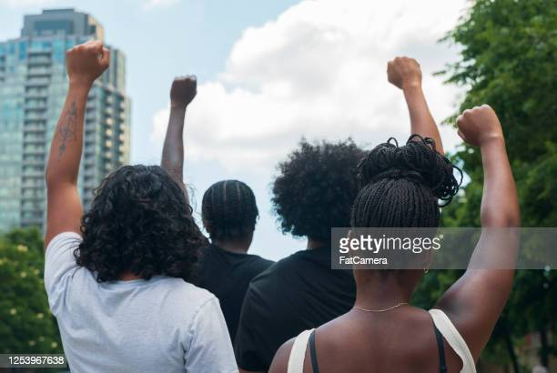 group of african american people protest - protestor stock pictures, royalty-free photos & images