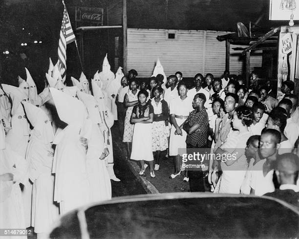 Group of African Americans confront a members of the Ku Klux Klan in 1938, after the secret organization's resurgence in the area following two...
