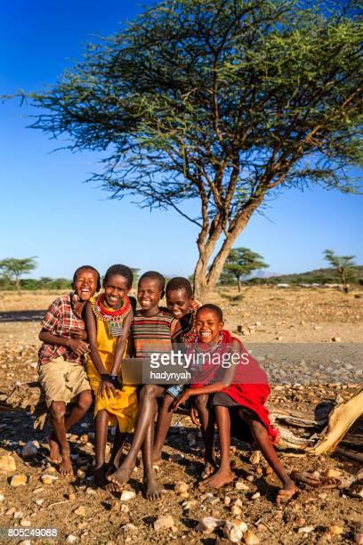 Group of African children using laptop, Kenya, East Africa