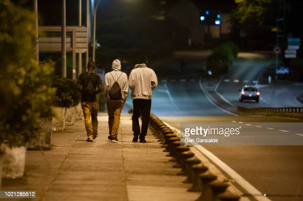 A group of African migrants headed to France to cross the SpanishFrench border walk along Santiago bridge on August 22 2018 in Irun Spain Migrants...