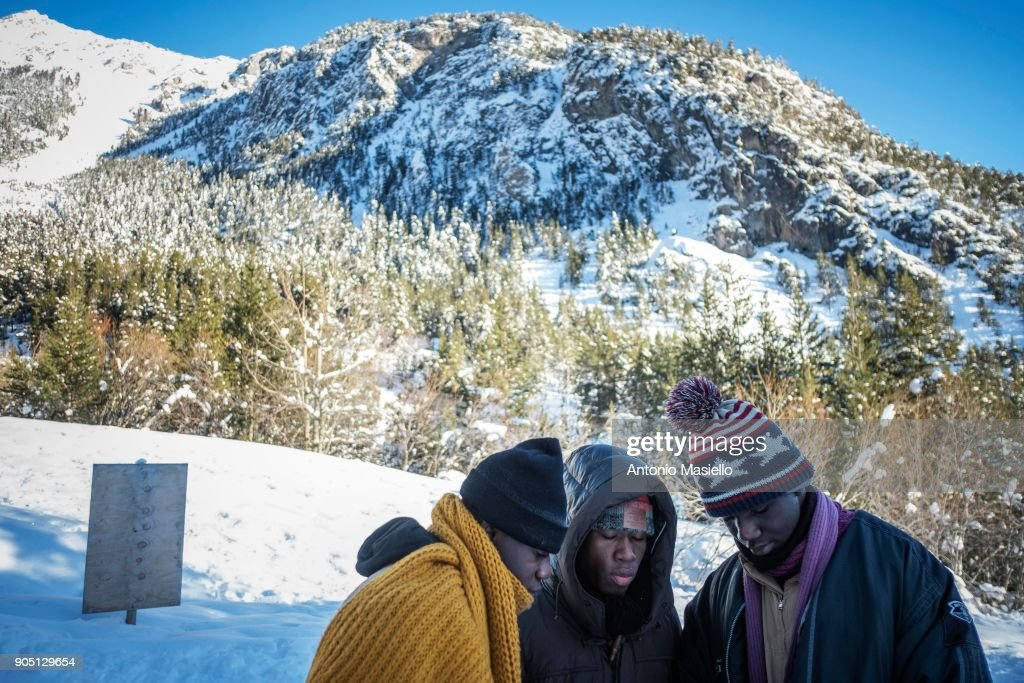 A group of African migrants including an unaccompanied minor walk through the snow to try and cross the border between France and Italy on January 15, 2018 in Bardonecchia, Italy. With the closure of the French border in Ventimiglia, many migrants and refugees are trying to cross the Italian-French border via the Colle della Scala (Italian Alps) despite the snow and extreme weather conditions. Many times in the last month, alpine rescue volunteers have climbed through the hairpin turns to recover migrants in difficulty.