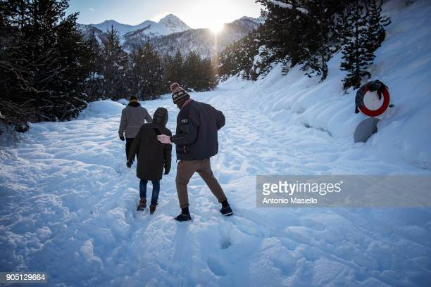 A group of African migrants including an unaccompanied minor walk through the snow to try and cross the border between France and Italy on January 15...