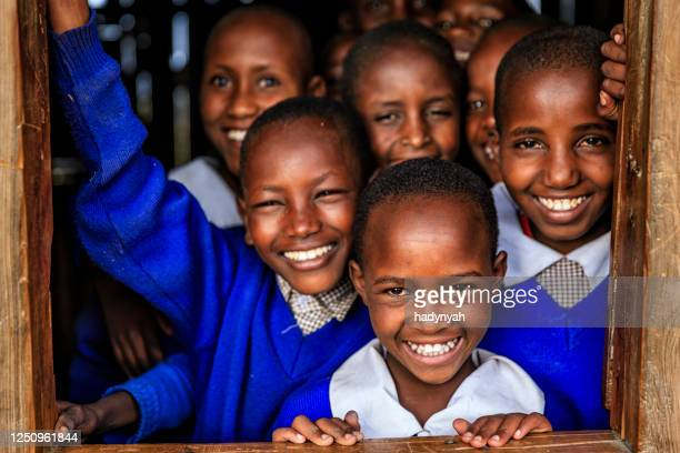 group of african school children inside classroom, kenya - africa stock pictures, royalty-free photos & images
