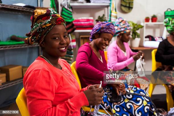 Group of African women in a weaving business
