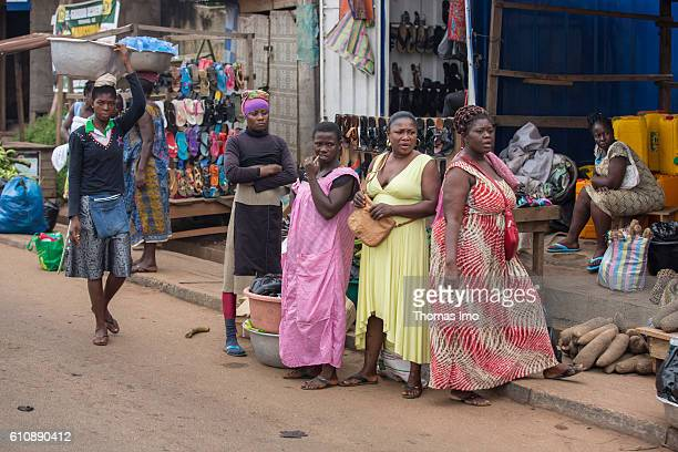 A group of African women stands in front of a shoe shop in a shopping street of Kumasi on September 06 2016 in Kumasi Ghana