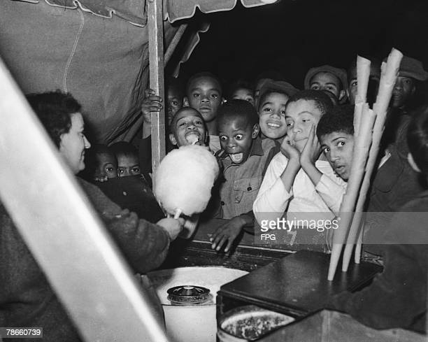 A group of AfricanAmerican boys at a cottoncandy stall 1949