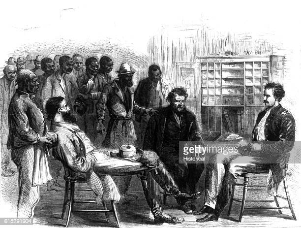 Group of African-American freedmen wait for the assistance of three officials at the Office of the Freedmen's Bureau, Memphis, Tennessee, 1866....