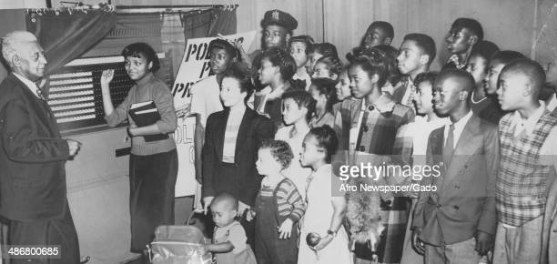 Group of African-American schoolchildren learn about the importance of voting during Black history week, Baltimore, Maryland, 1964.