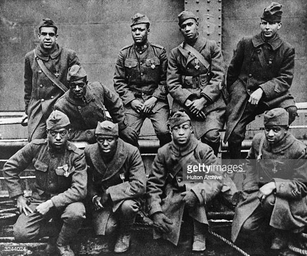 Group of African-American soldiers returning home from Europe after World War I. They are all wearing the Croix de Guerre of France, which they were...