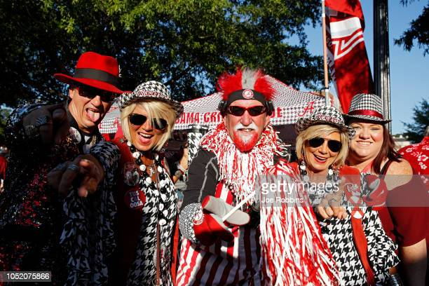 A group of Alabama Crimson Tide fans get ready before the game against the Missouri Tigers at BryantDenny Stadium on October 13 2018 in Tuscaloosa...