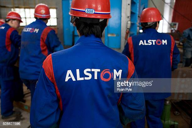 A group of Alstom engineers work inside a workshop preparing turbines for the Three Gorges Dam The Three Gorges Dam Project in Yicheng Hubei China is...