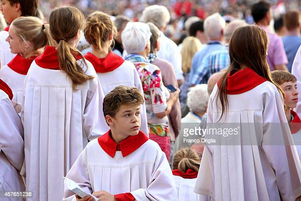 A group of altar servers attend Pope Francis' weekly audience in St Peter's Square on October 22 2014 in Vatican City Vatican Speaking to the crowds...