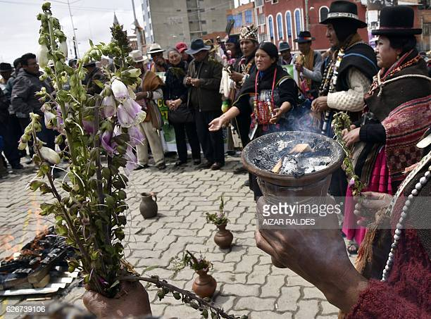 A group of 'amautas' masters in Quechua language take part in the ritual of Jallupacha to ask for rains on November 30 2016 in El Alto Bolivia...