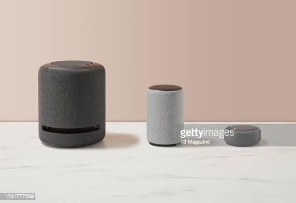 Group of Amazon Echo smart speakers, including Echo Studio, Echo and Echo Dot models, taken on September 24, 2020.