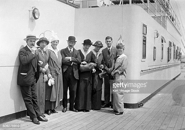 A group of American adults gathers for a portrait on the deck of a cruise ship while touring Europe early in the 20th century