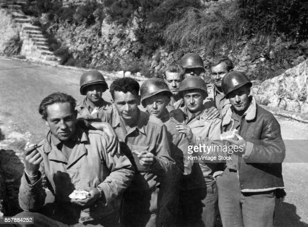 Group of American GIs rest at the roadside during the Allies campaign in Italy, 1943-45.