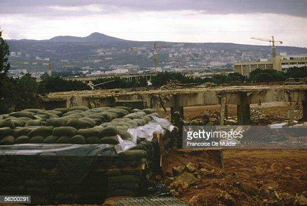 A group of American Marines by the entrance of a half underground bunker covered in sandbags Beirut early 1980s The US Marines were there as part of...