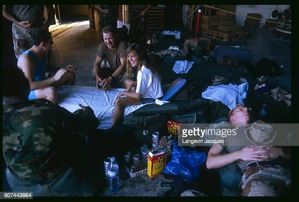 A group of American soldiers relax after arriving in Saudi Arabia for the Persian Gulf War In August of 1990 Iraqi president Saddam Hussein invaded...
